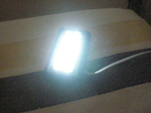 Phone line-powered flashlight